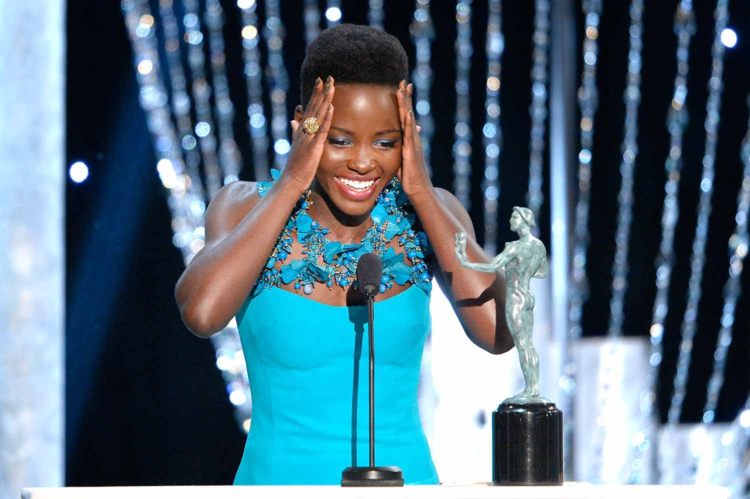 lupita Nyongo accepts the outstanding performance by afemale actor in a supporting role-award-for 12 years a slave onstage during the 20th annua -screen actors guild awards