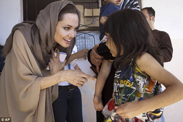Angelina Jolie meeting a Syrian refugee back in 2012