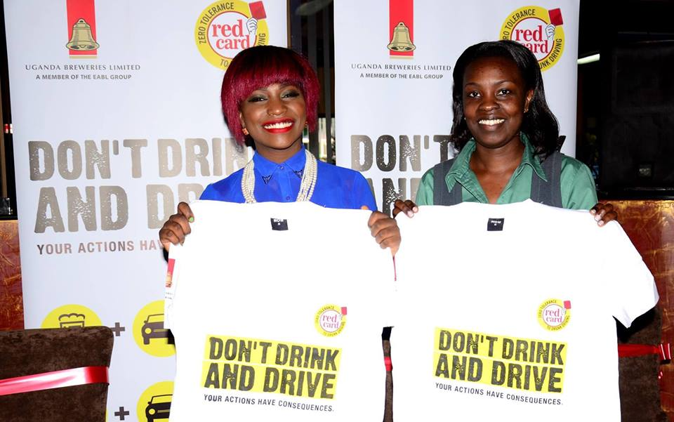 Musician Irene Ntale (L), and Ms. Charity Kiyema (R), the Corporate Relations and Legal Director Uganda Breweries Limited