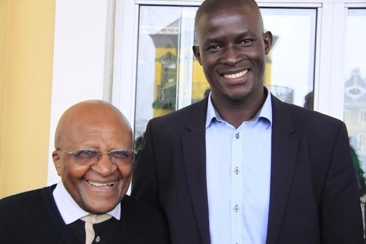 Victor Ochen with Bishop Desmond Tutu
