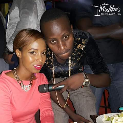 Mc Kats poses with a fan.