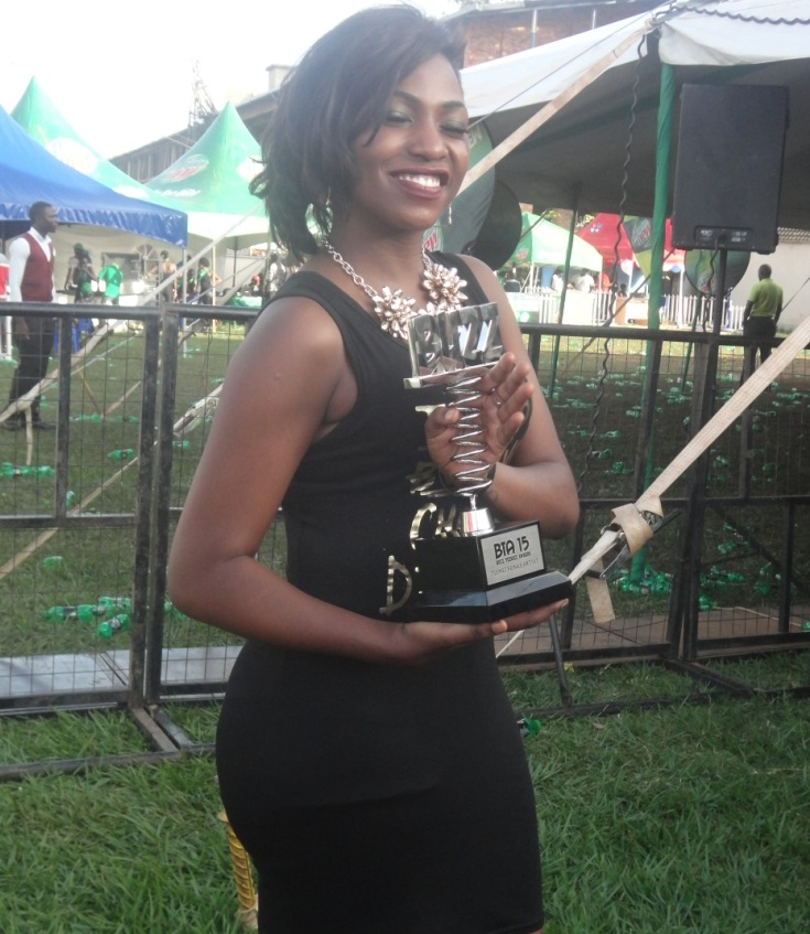 Irene Ntale shows off her Buzz Teeniez award