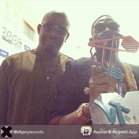 D'banj (holding award) with Don Jazzy