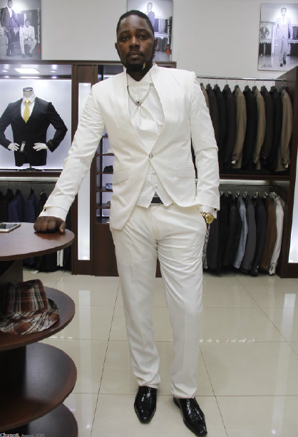 Gareth Onyango looks dapper in a white suit