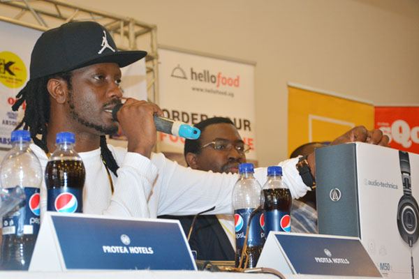 Bebe Cool shows off the headsets at the press conference
