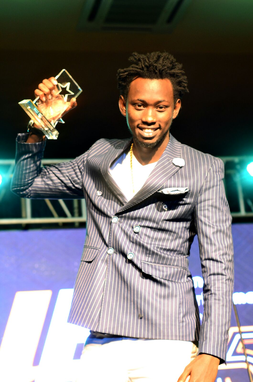 Levixone shows off his award.