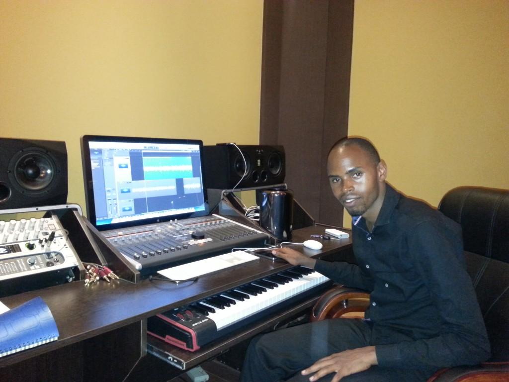 Alex Muhangi at his work station