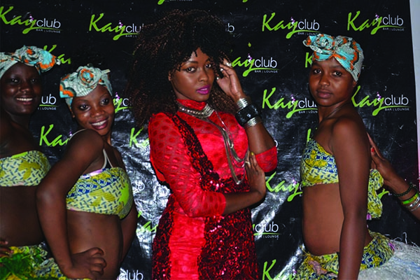 Grace Nakimera poses with her dancers