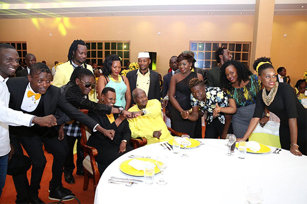 Ugandan artistes pose with the president