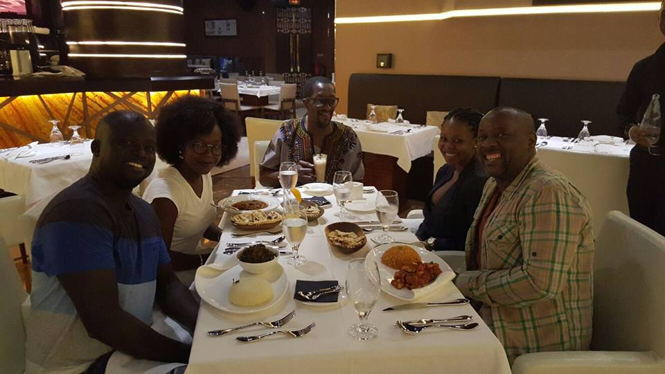 Anne Kansiime with her hubby Ojok, manager and other colleagues