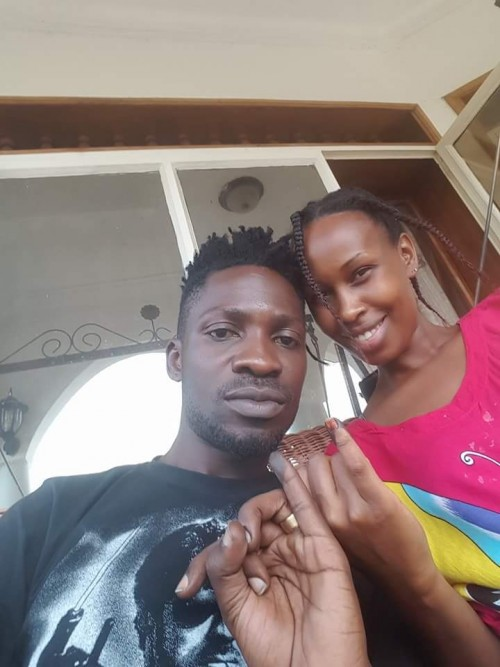 Bobi Wine and his wife Barbie show off the ink on their fingers which is a sign that they voted