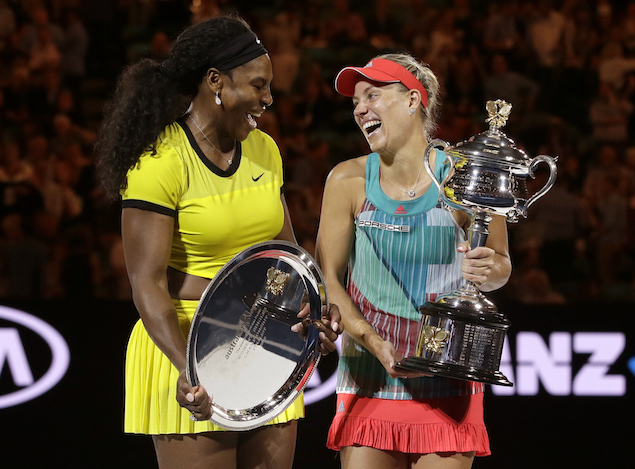 Angelique Kerber, right, of Germany enjoys a joke with runner-up Serena Williams of the United States after winning their women's singles final at the Australian Open tennis championships in Melbourne, Australia, Saturday, Jan. 30, 2016.(AP Photo/Aaron Favila)