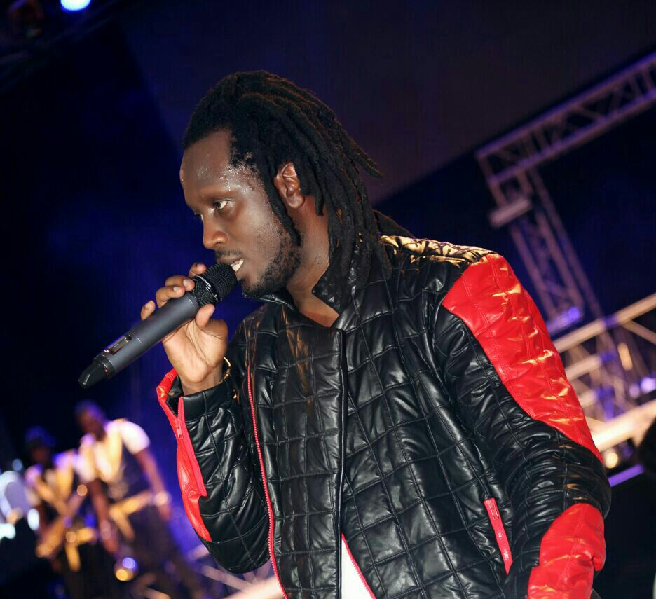 Bebe Cool was in his white Mercedes Benz as he got petrol from the Total station