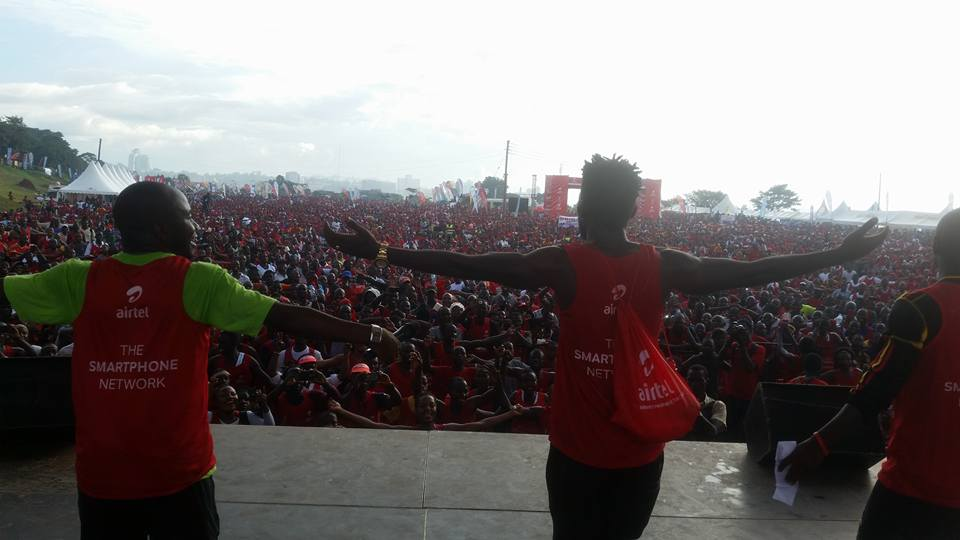 Bobi Wine welcomes a crowd of people at the Kabaka run