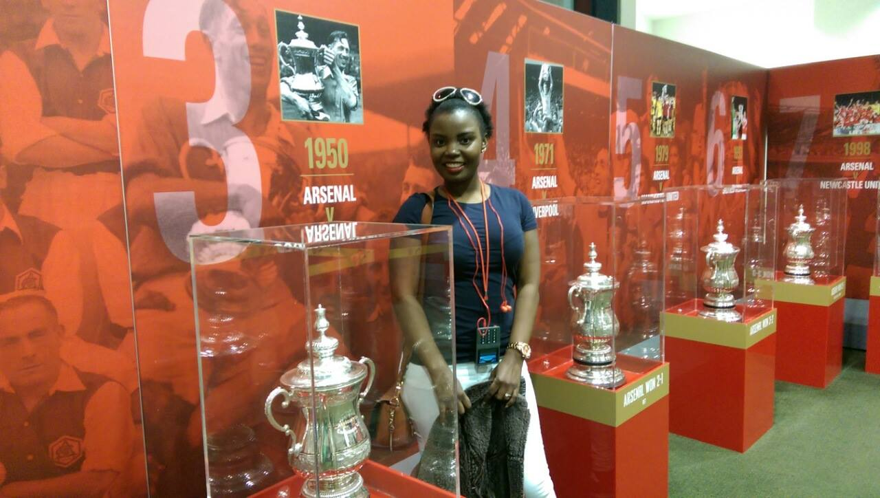 Mary Luswata Posing In Arsenal Football Clubs Trophy Locker Room