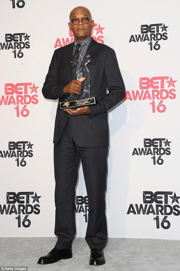 Samuel shows off his BET lifetime award