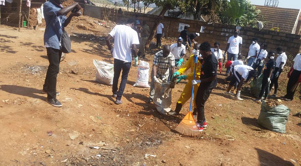 Bobi Wine cleans one of the areas in Kamwokya