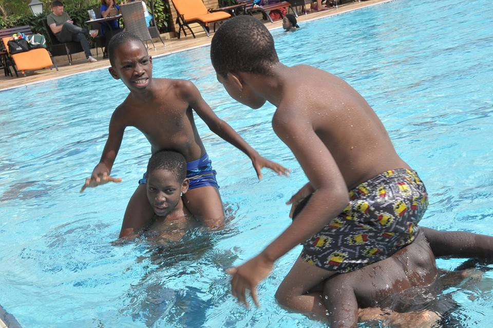 Solomon Kampala enjoys himself with friends