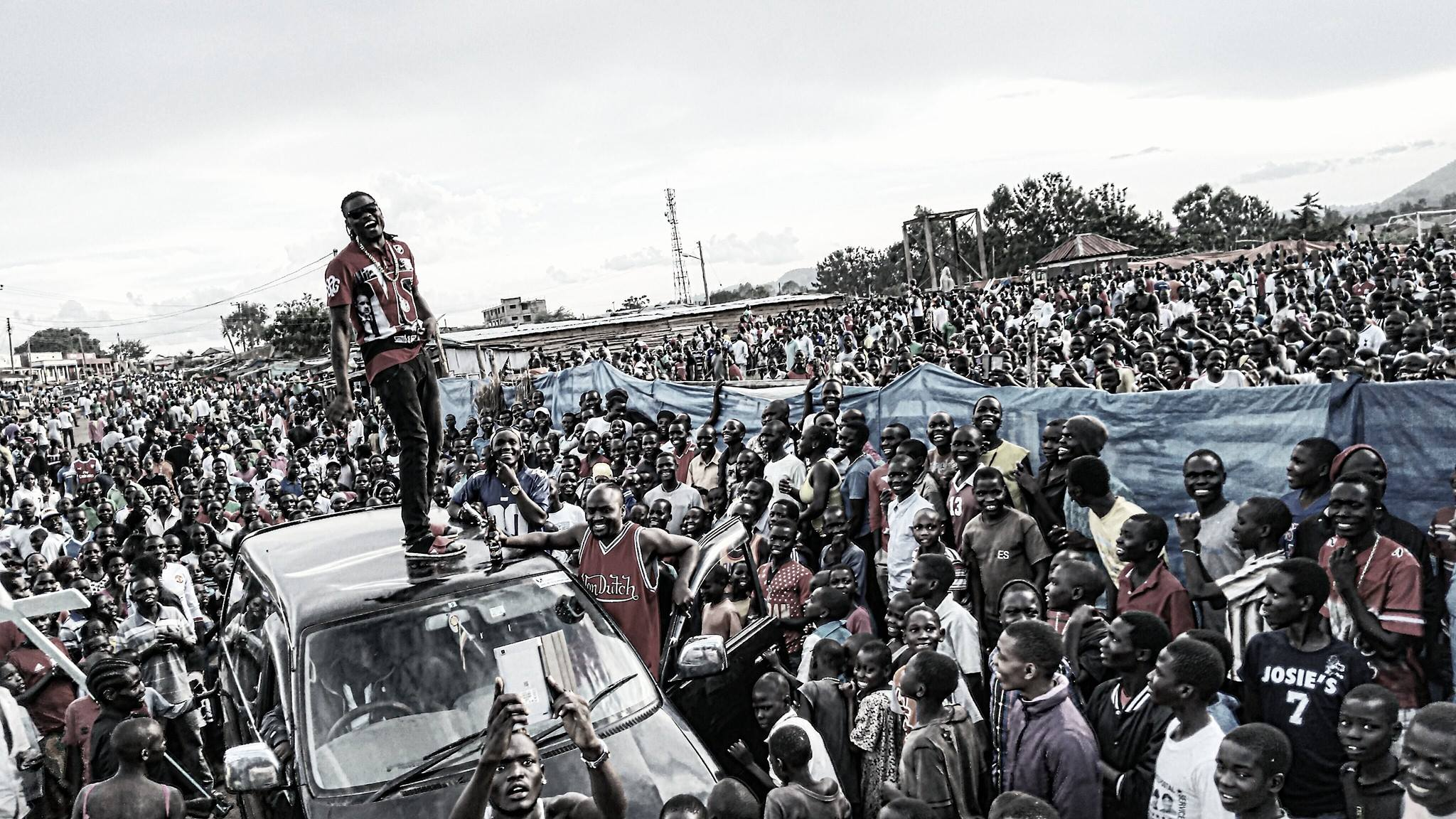Pallaso stands on top of a car in the West Nile region