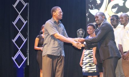 ubls-corporate-relations-manager_-david-onyango-receives-the-award-for-best-campaign-for-consumer-issues-from-the-private-sector-foundation-executive-director-mr-gideon-badagawa