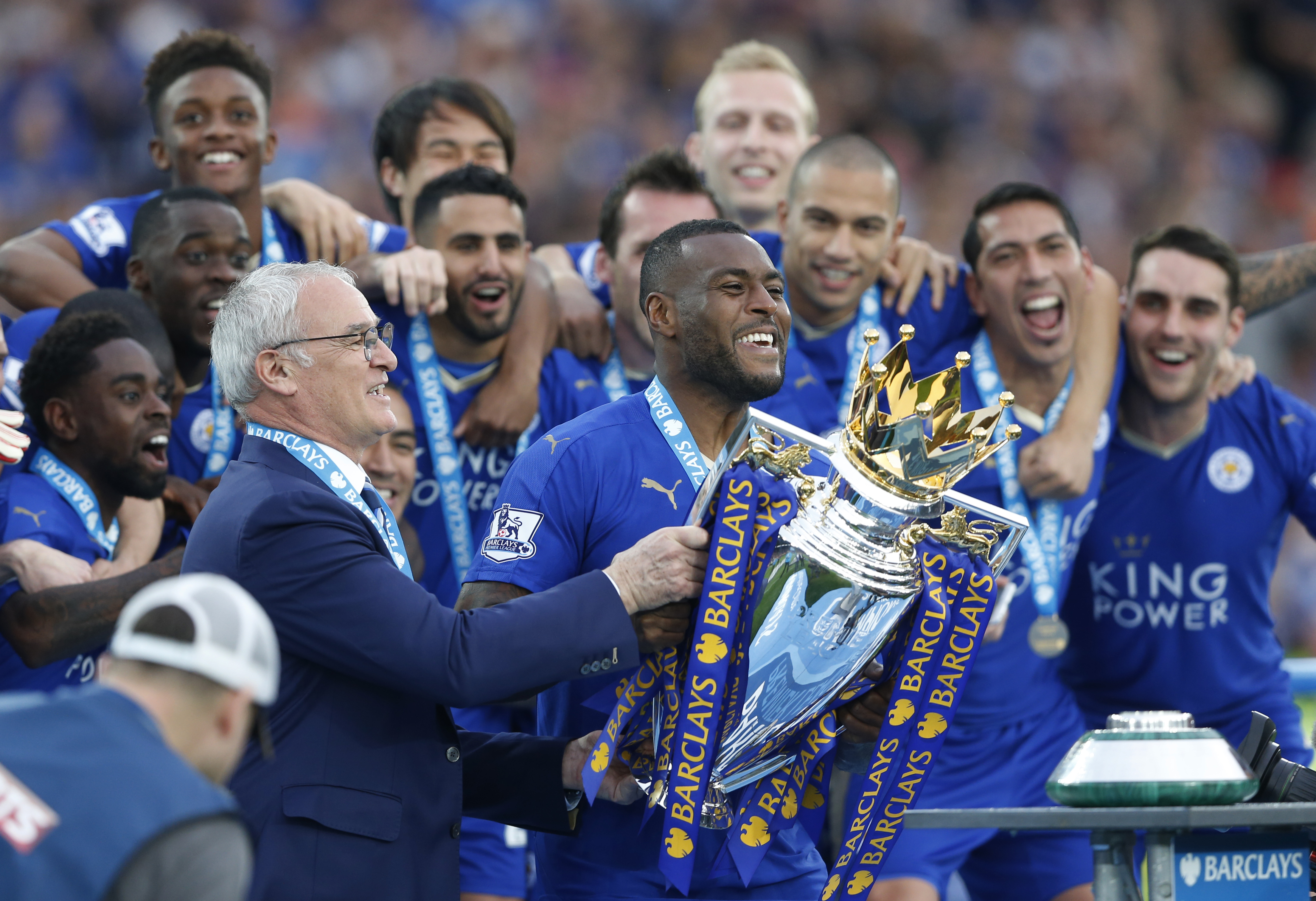 """Britain Soccer Football - Leicester City v Everton - Barclays Premier League - King Power Stadium - 7/5/16 Leicester City's Wes Morgan and manager Claudio Ranieri lift the trophy as they celebrate winning the Barclays Premier League Action Images via Reuters / Carl Recine Livepic EDITORIAL USE ONLY. No use with unauthorized audio, video, data, fixture lists, club/league logos or """"live"""" services. Online in-match use limited to 45 images, no video emulation. No use in betting, games or single club/league/player publications. Please contact your account representative for further details."""