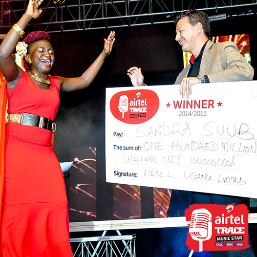 Sandra Suubi receives her 100 million cheque
