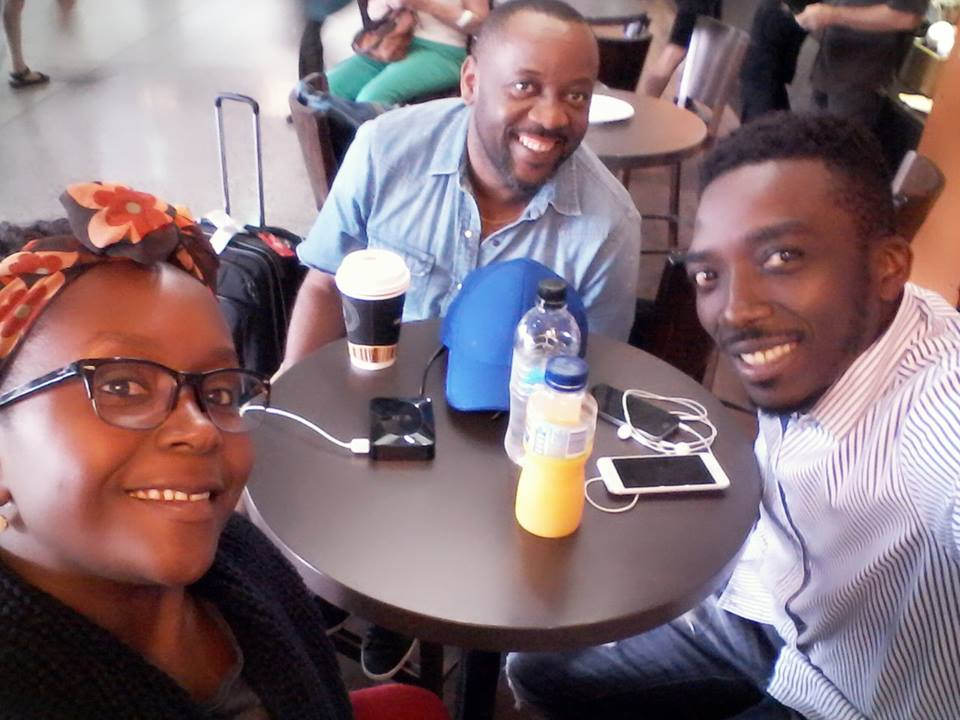 Anne Kansiime with manager Johnson Mujungu (middle) and another colleague