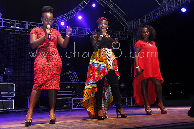 Sandra Suubi (centre) performs at the Airtel inspiring women concert with former contestants.