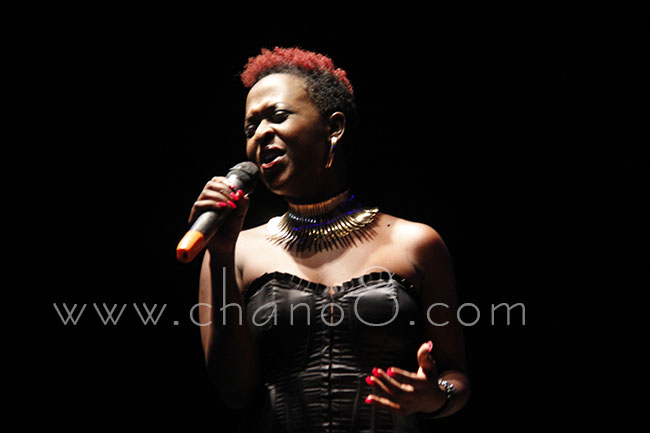 Lillian Mbabazi dressed all in black performs her new song Kuma Obudde