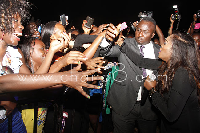 Up close and personal, Tiwa Savage shakes hands with fans
