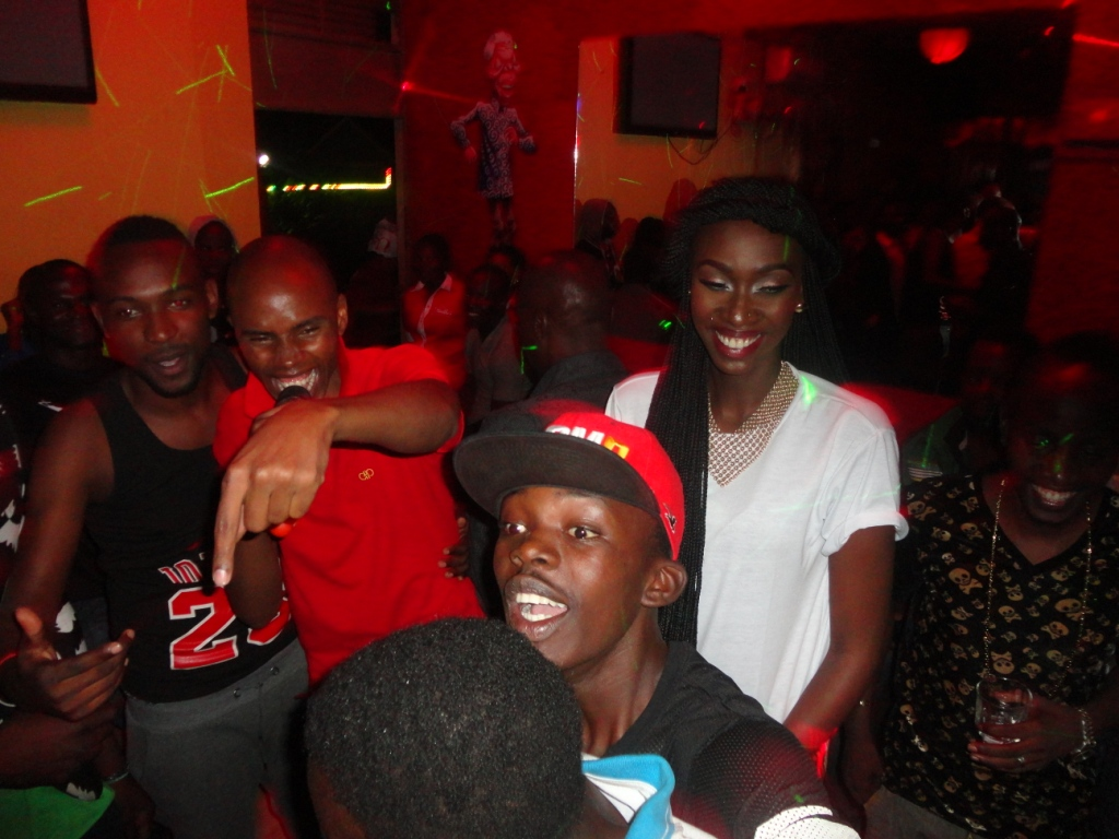 Alex Muhangi (in red) and Judith Heard
