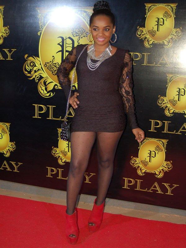 A stunning chic poses at Club Play