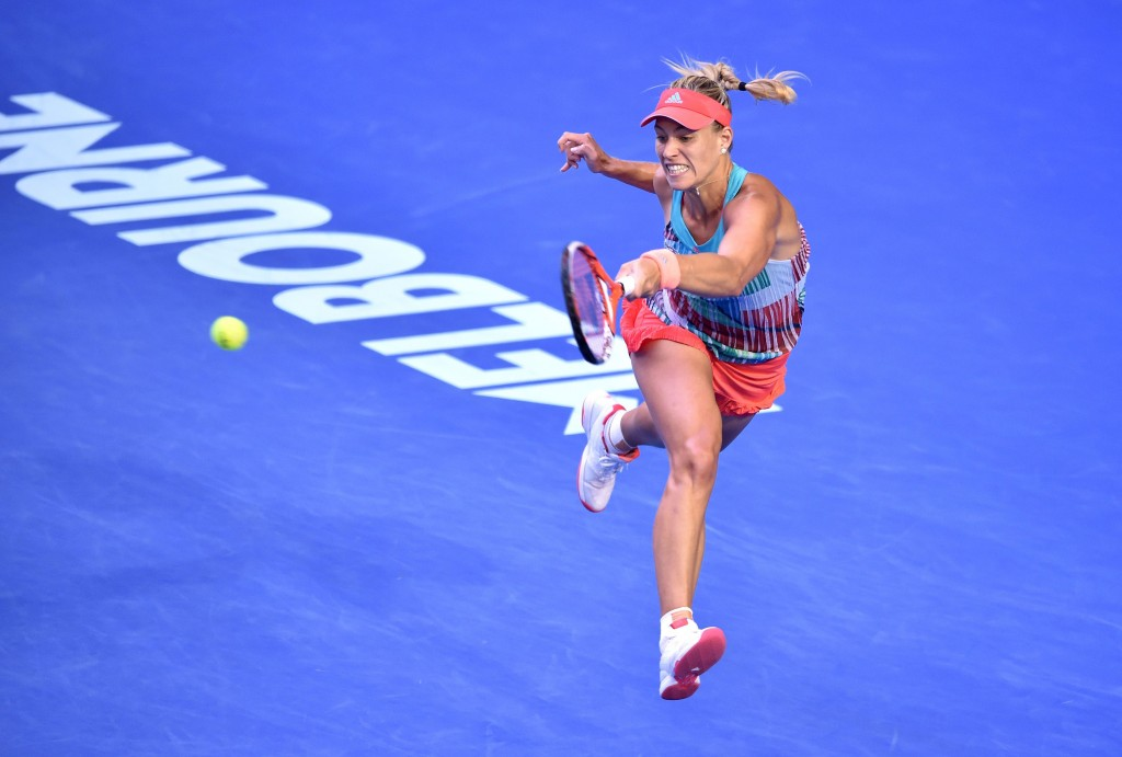 Angelique Kerber of Germany hits a return against Serena Williams of the US in their women's singles final match on day 13 of the 2016 Australian Open tennis tournament in Melbourne on January 30, 2016. AFP PHOTO / PETER PARKS -- IMAGE RESTRICTED TO EDITORIAL USE - STRICTLY NO COMMERCIAL USE