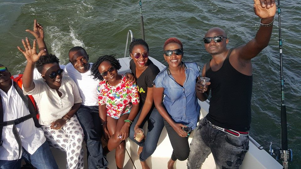 Kansiime on a boat cruise with friends