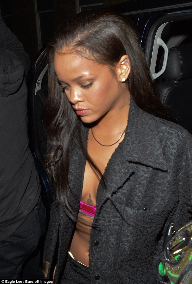 Rihanna leaves little to the imagination as she party's with Drake for the third day