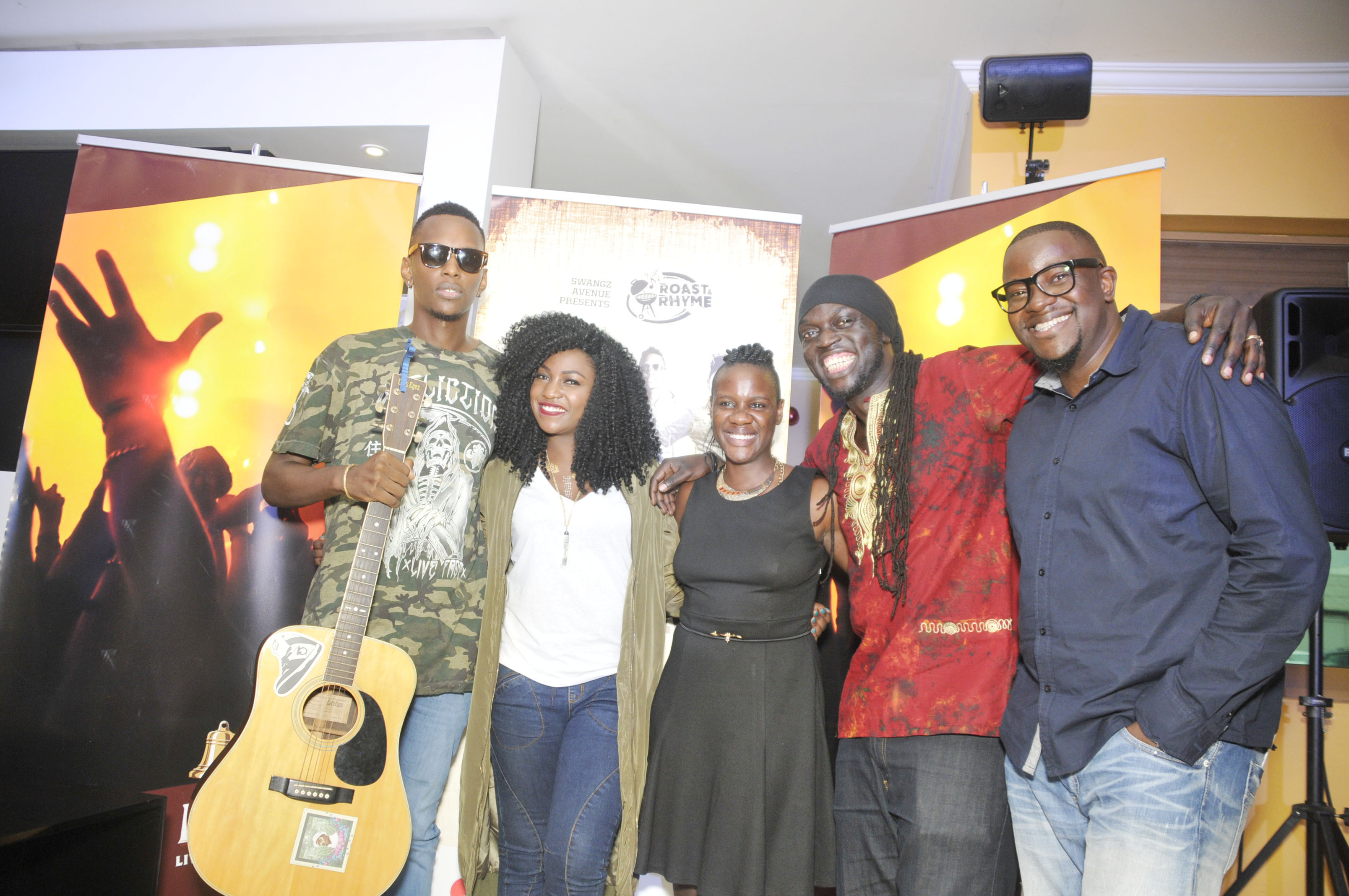 bell-lager-brand-manager-maureen-rutabingwa-centre-swangz-avenues-benon-mugumbya-flanked-by-musicians-allan-tonix-irene-ntale-and-babaluku-the-musicians-will-be-performing-live-at-roast-and-rhy